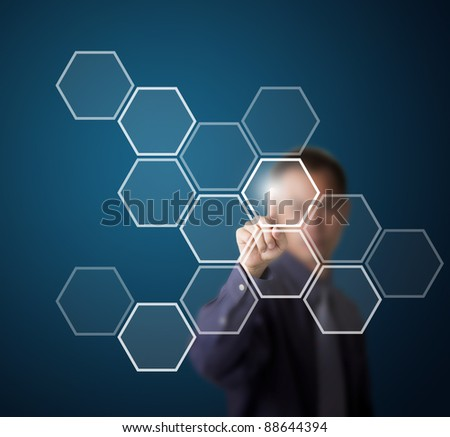 business man push a hexagonal touch screen button - stock photo