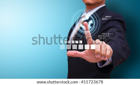Business man push the power button - stock photo