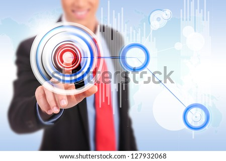business man pushing a circle button on a graph application screen - stock photo