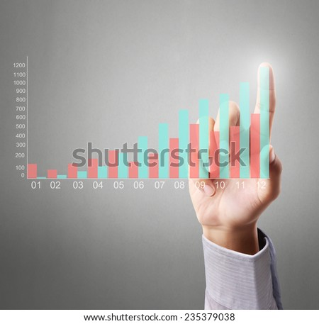 Business man pushing the graph  - stock photo
