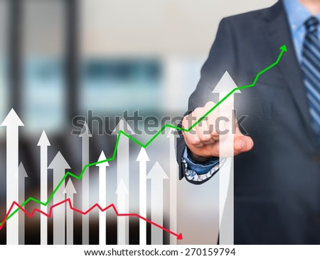 Business man pushing the graph on visual screen. Man finger on growth line. Business stock, technology concept. Isolated on office. Stock Image