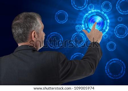 business man pushing virtual digital data - stock photo