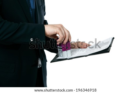 business man puts a stamp contract - stock photo