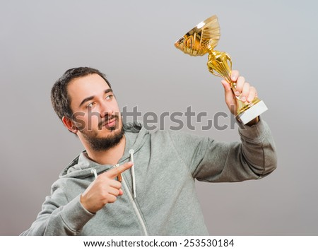 business man raising his trophy  - stock photo
