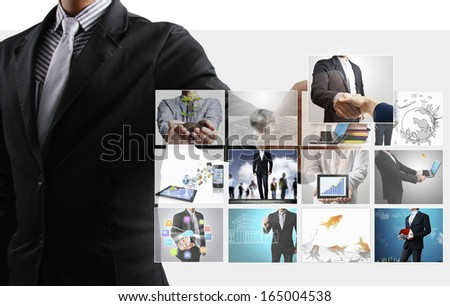 Business man reaching images streaming from the deep  - stock photo