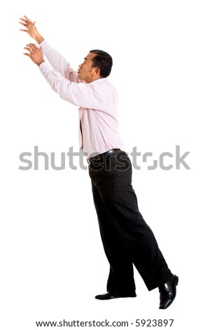 business man reaching up to something imaginary - isolated over a white background