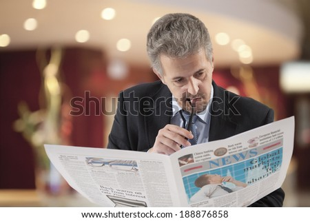 Business man reading a newspaper, cafe backgrounds