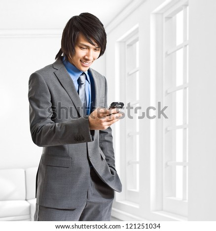 Business man reading a text message - stock photo