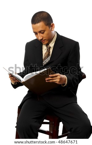 Business man reading book while sitting on chair isolated on white background - stock photo