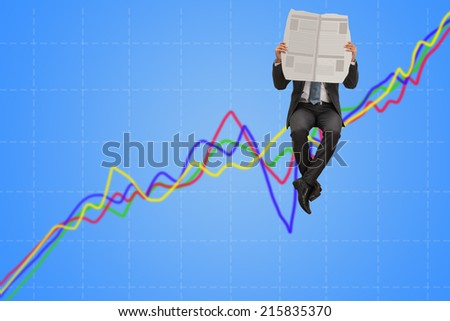 business man reading newspaper on line chart - stock photo