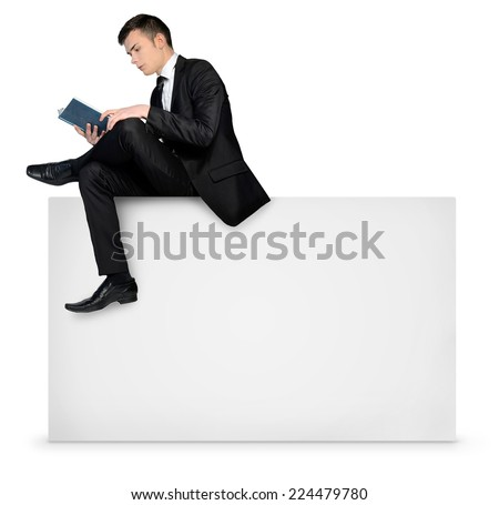 Business man reading on empty board - stock photo