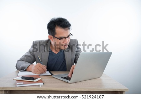 business man  reads information on the screen