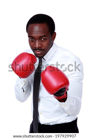 Business man ready to fight with boxing gloves isolated over white background