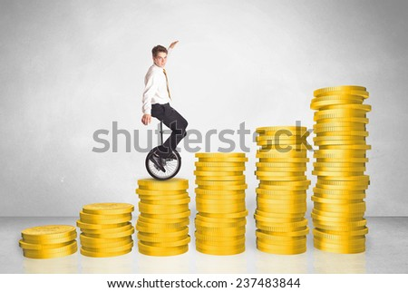 Business man riding monocycle up on coin graph concept on background