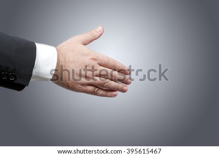 Business man right hand ready to shake another hand sealing a contract