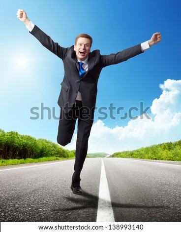 business man run on the road - stock photo