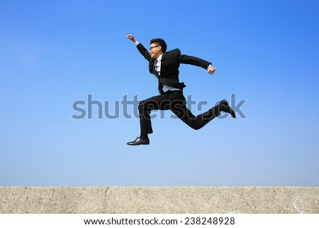 business man running with blue sky background, full length, asian male - stock photo