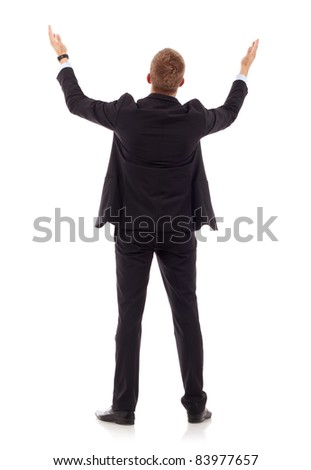 business man's back praying with his arms up , over white