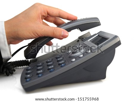 business man's hand is picking up headset - stock photo