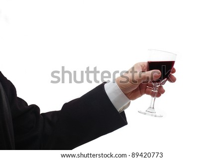 Business man's hand with red wine