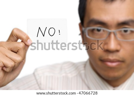 Business man say no by holding one card on white background. Focus on card. - stock photo