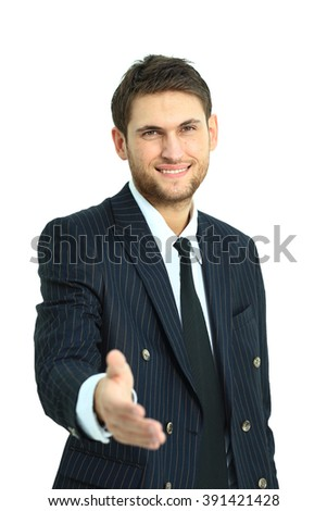Business man saying welcome and giving hand. Focused on hand. - stock photo
