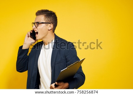 business man screams on some phone.