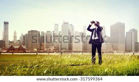 Business Man Searching Binoculars Outdoors Concept - stock photo