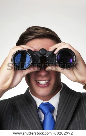 business man searching with binoculars - stock photo