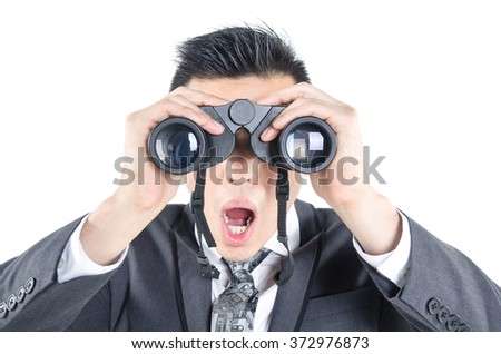 Business man seeking with binocular isolated on white background
