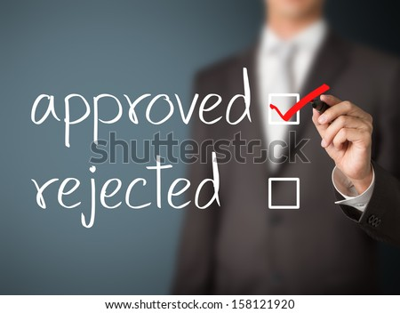 business man selecting approval