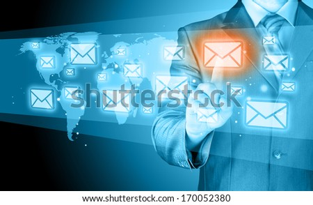 Business man send email from phone or smartphone. Email icon flying around. - stock photo
