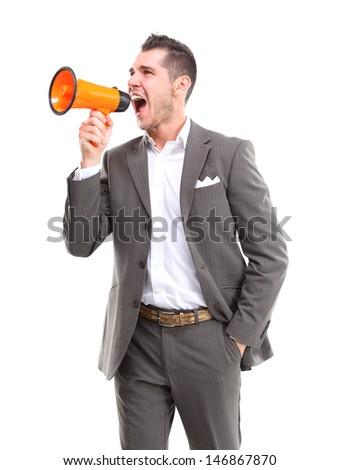 Business man shouting through megaphone - stock photo