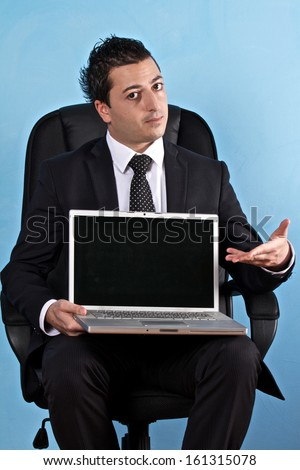 Business man show the laptop monitor blank - stock photo
