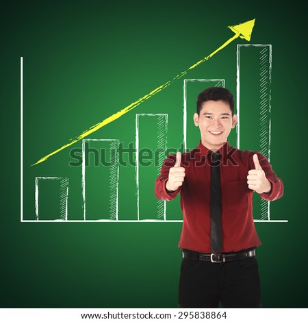 Business man show two thumbs up. Business success concept