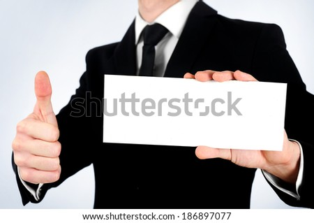 Business man showing card and agree