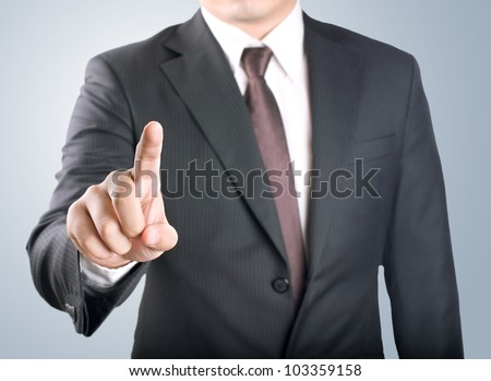 Business man showing finger to be number one