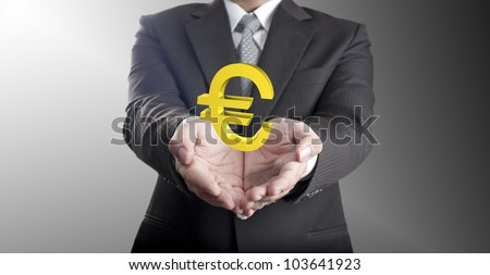 Business man showing green Euro currency sign. Concept for Europe economic crisis