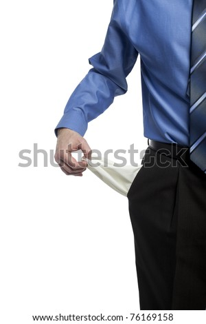 business man showing his empty pockets demonstrating he has no money - stock photo