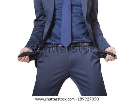 Business man showing his empty pockets isolated on a white background - stock photo