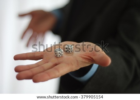 Business man showing his hand with a pair of dice - stock photo