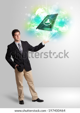 Business man showing modern green tablet technology concept