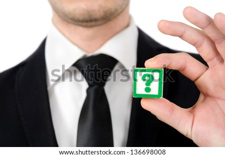 Business man showing question mark - stock photo