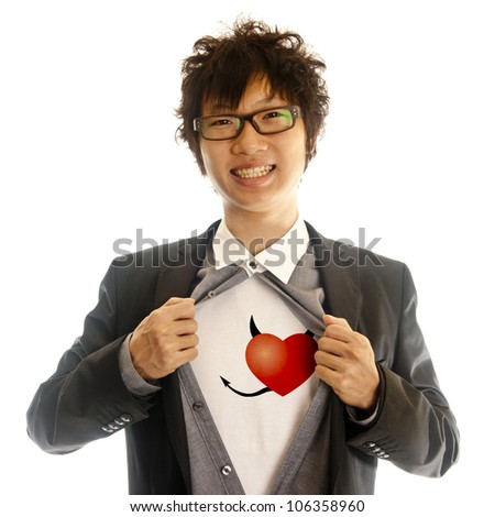 business man showing red evil heart inside of his suit - stock photo