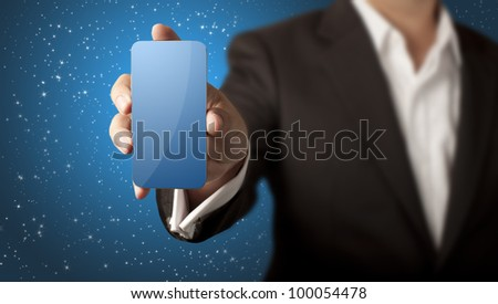 Business man showing smart phone with blank blue screen and stars in blue background - stock photo