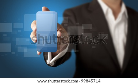 Business man showing smart phone with icons in blue background - stock photo
