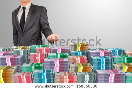business man showing stack of euro money - stock photo