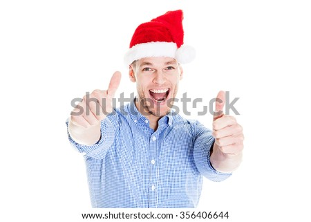 Business man showing thumb up, everything is OK in the winter. Corporate party, Christmas hat isolated portrait of a man on a white background, studio photo. - stock photo
