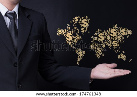 business man showing World map made with dollar sign - stock photo