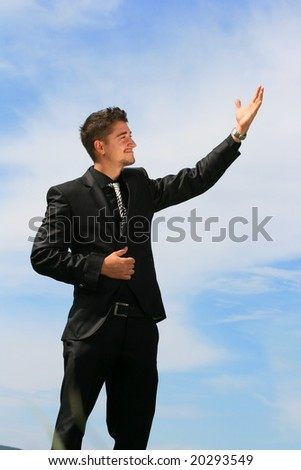 Business man shows ascending trend. - stock photo
